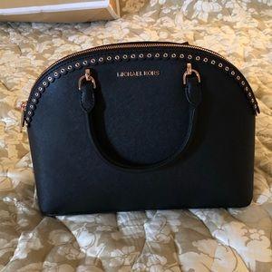 Black Michael Kors handbag with rose gold hardware